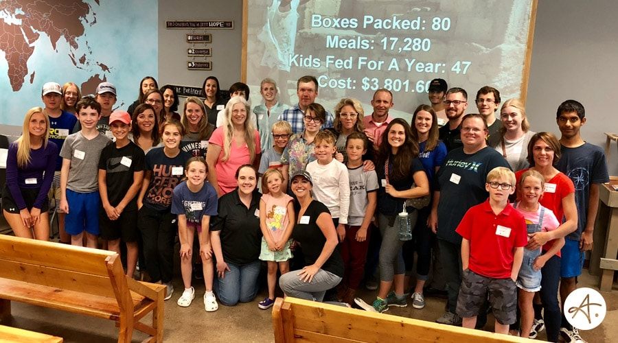 Authentic Brand and Two Or More: Service Event at Feed My Starving Children