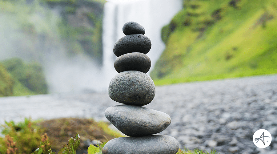 Perfectly balanced stones with waterfall background